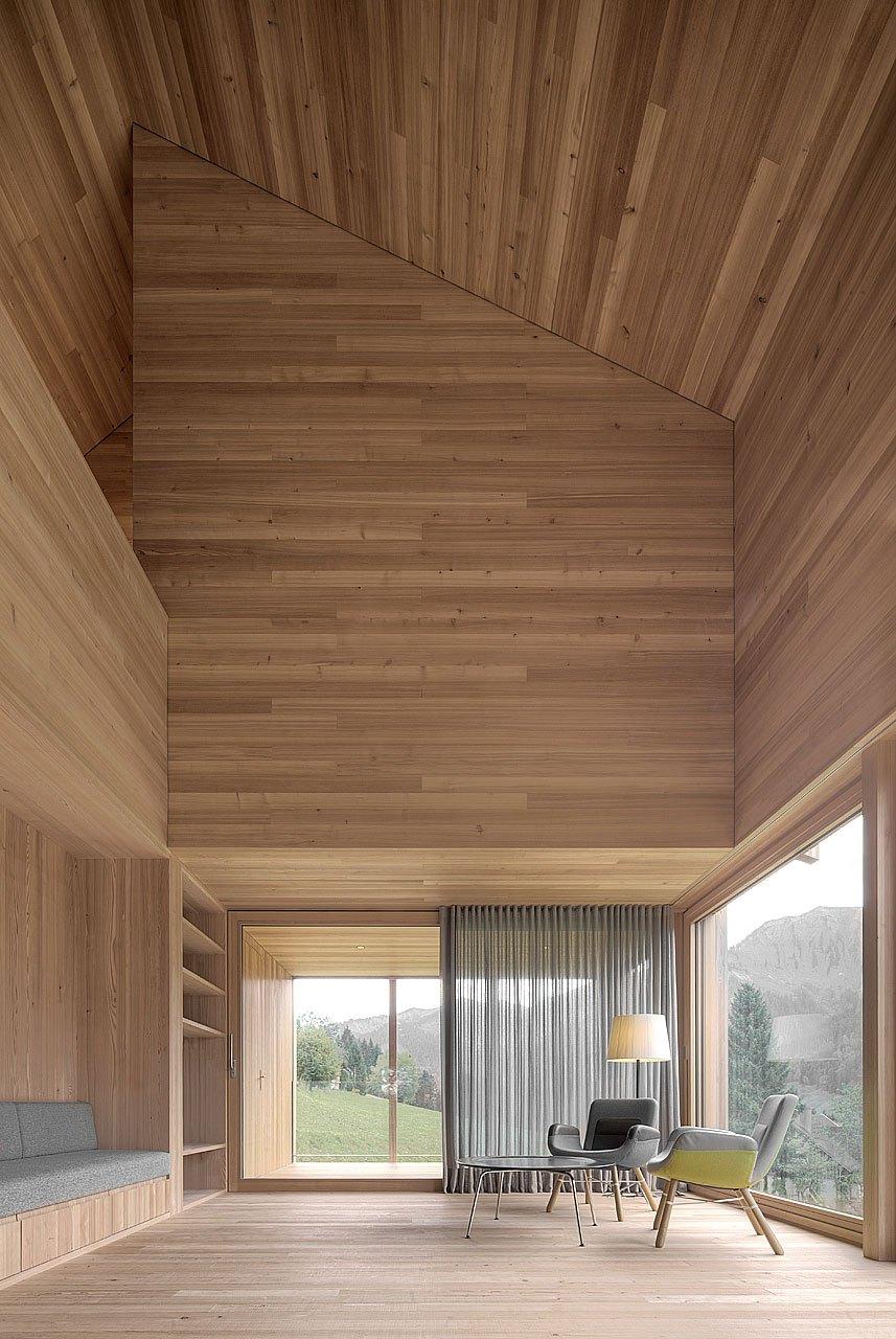 Moderna casa de campo grandes ventanales con vistas a los bosques de Austria 4