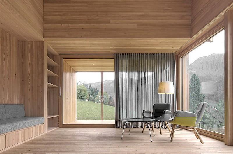 Moderna casa de campo grandes ventanales con vistas a los bosques de Austria