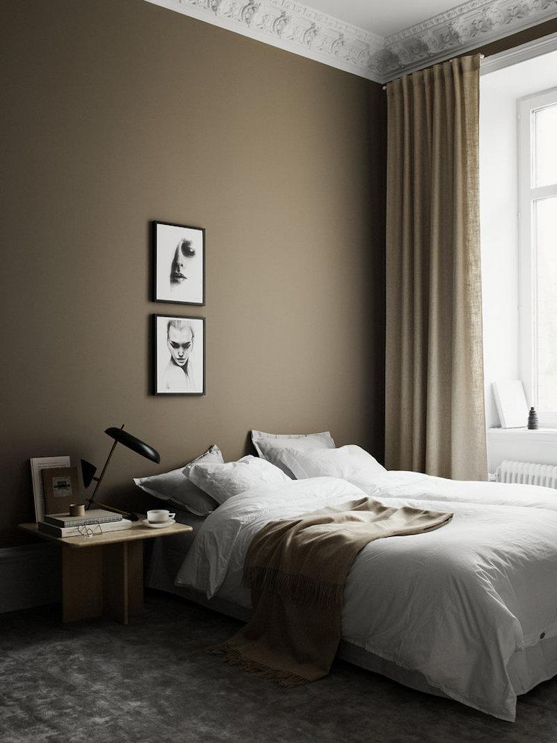 Dormitorio sobrio paredes oscuras color marron avellana obras arte negro y grises 2