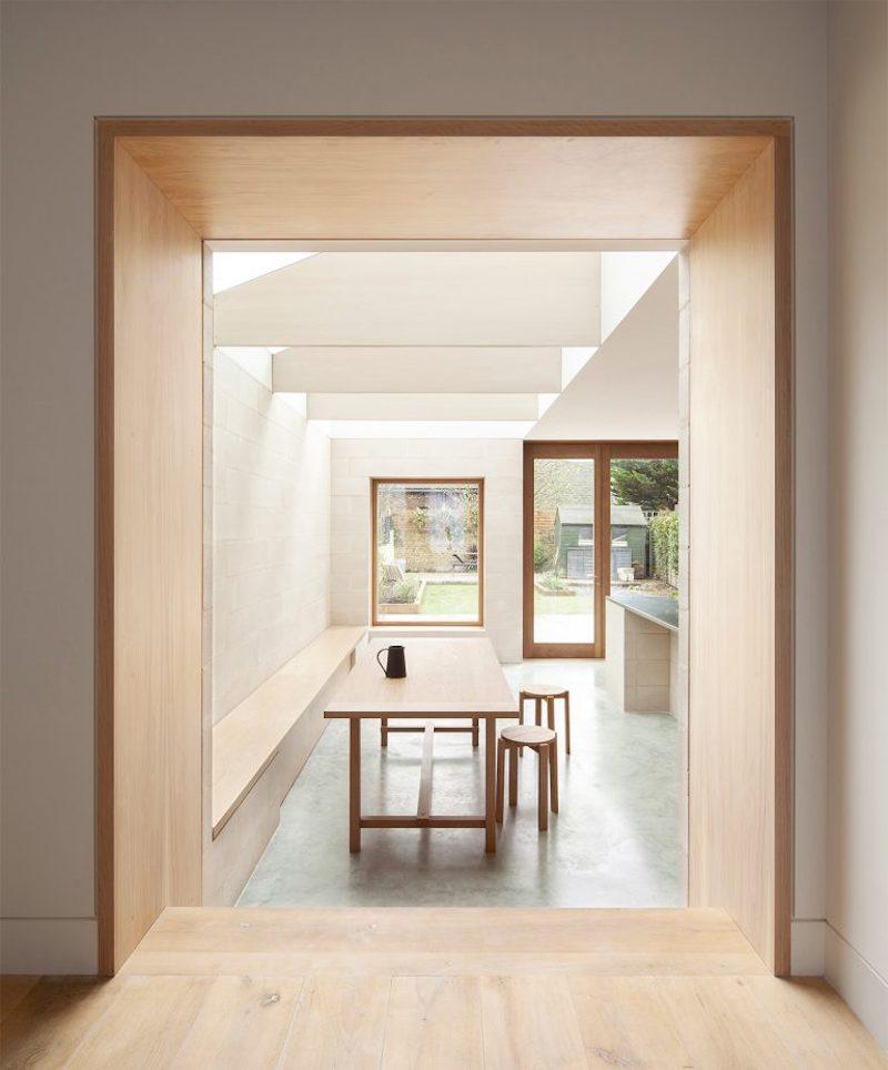 Proyecto obra nueva vivienda cemento pulido ladrillo visto cocina mobiliario madera 1