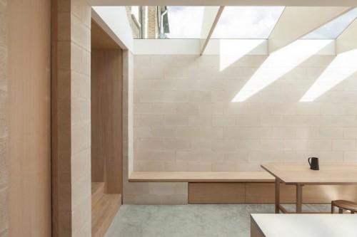 Proyecto obra nueva vivienda cemento pulido ladrillo visto cocina mobiliario madera